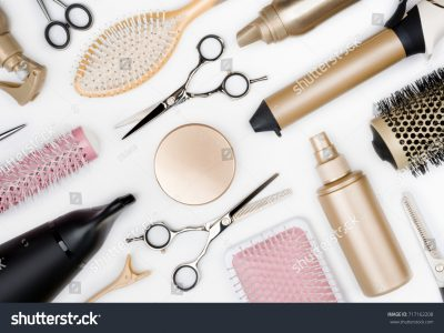 stock-photo-hairdressing-tools-and-various-hairbrushes-on-white-background-top-view-717162208